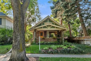 Sold! Charming 1 ½-story brick bungalow in the heart of the Country Club North