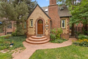 "Sold!  Vintage brick Tudor with ""secret garden"" yard on premier block"